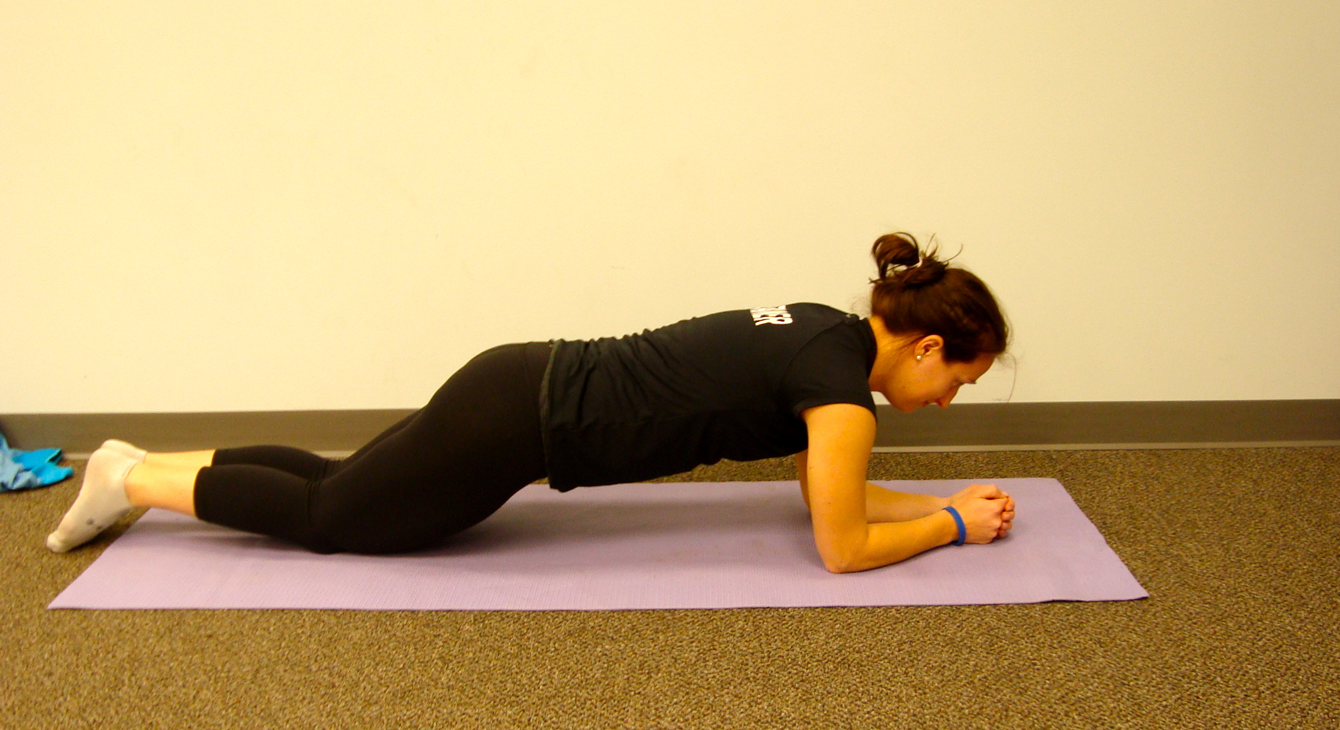Plank on knees - Start higher if you are having a hard time holding a plank on your toes