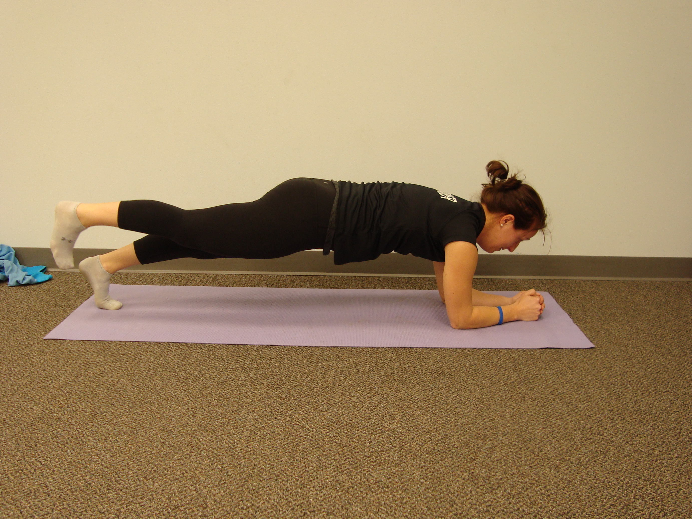 Plank Progression #4: Single-leg Plank - Lift one leg up while maintaining the plank position